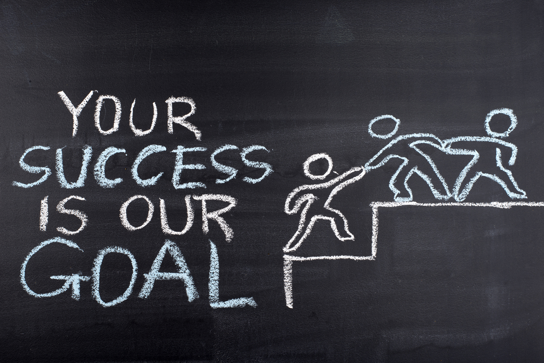 Your success is our goal hand drawing on blackboard